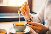 woman drink hot orange tea in cafe