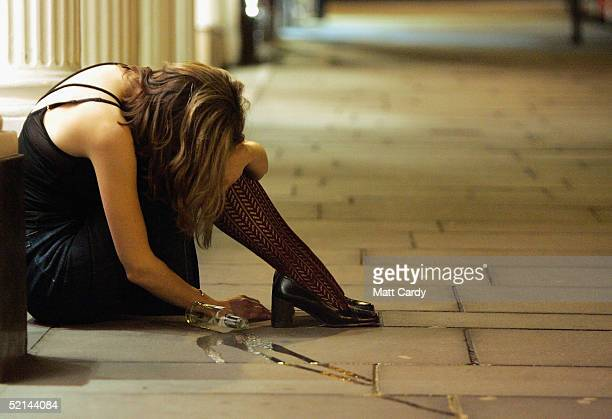 A woman drinker slumps on the pavement February 5 2005 Bristol England This weekend was the last one before pubs and clubs can apply for extended...