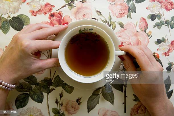 A woman drinking a cup of tea
