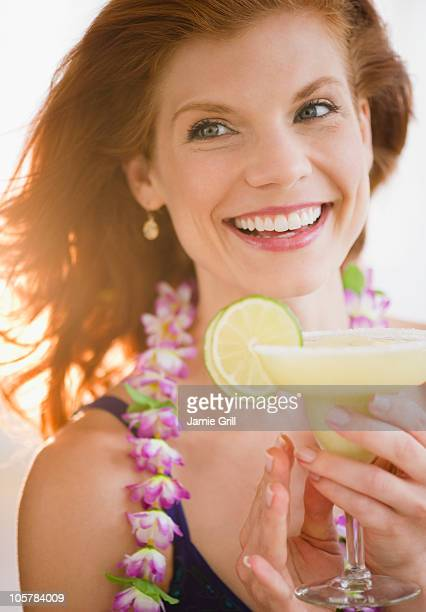 Woman drinking a frozen cocktail