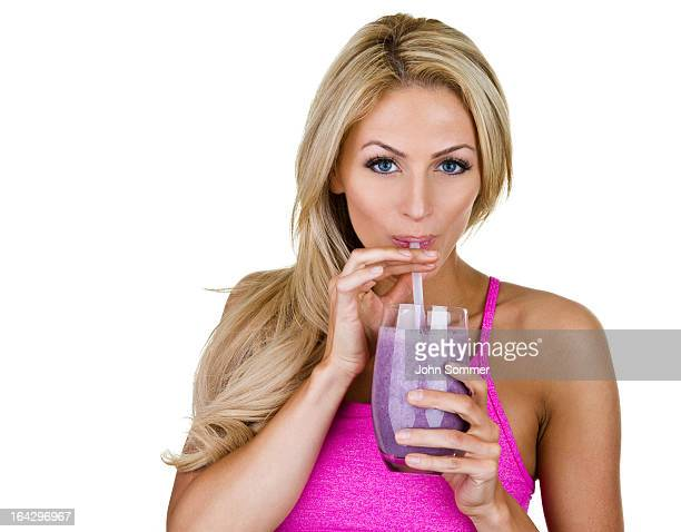Woman drinking a fruit smoothie