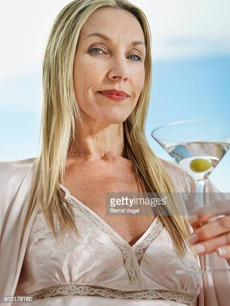 Woman Drinking a Martini