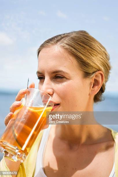 Woman drinking an iced tea