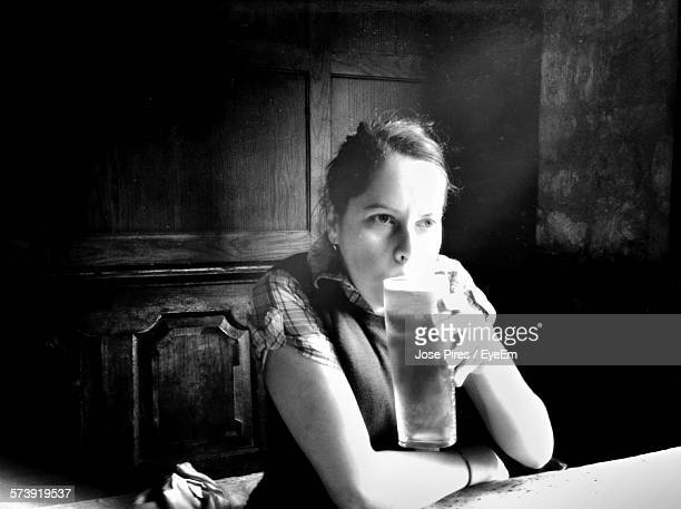Woman Drinking Beer At Restaurant