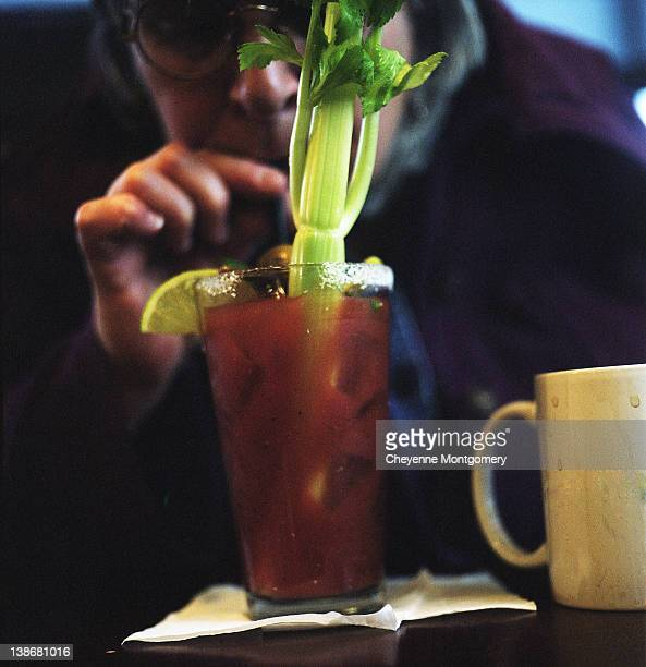 Woman drinking Bloody Mary cocktail