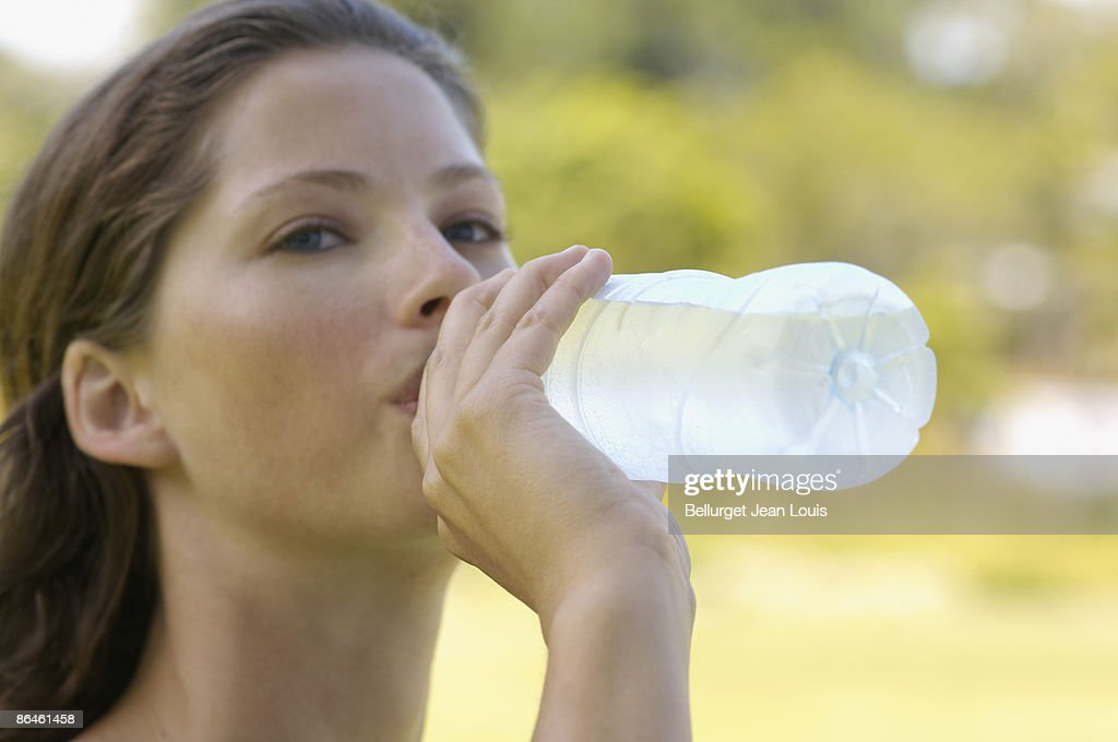woman drinking bottled water stock photo getty images
