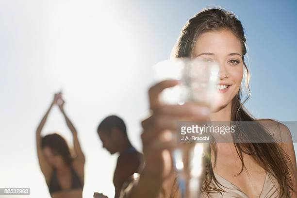 Woman drinking champagne with friends