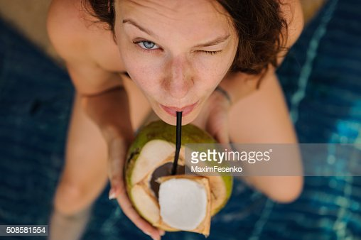 woman drinking coconut . Happy carefree freedom girl in summer day. : Stock Photo
