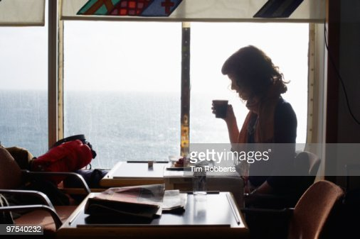 Woman drinking coffee on ferry. : Stock Photo