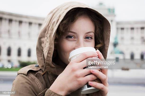 Woman drinking coffee to go.