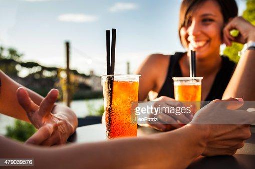 Woman drinking enjoying a summer happy hour