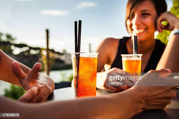 Woman drinking enjoying a summer happy hour
