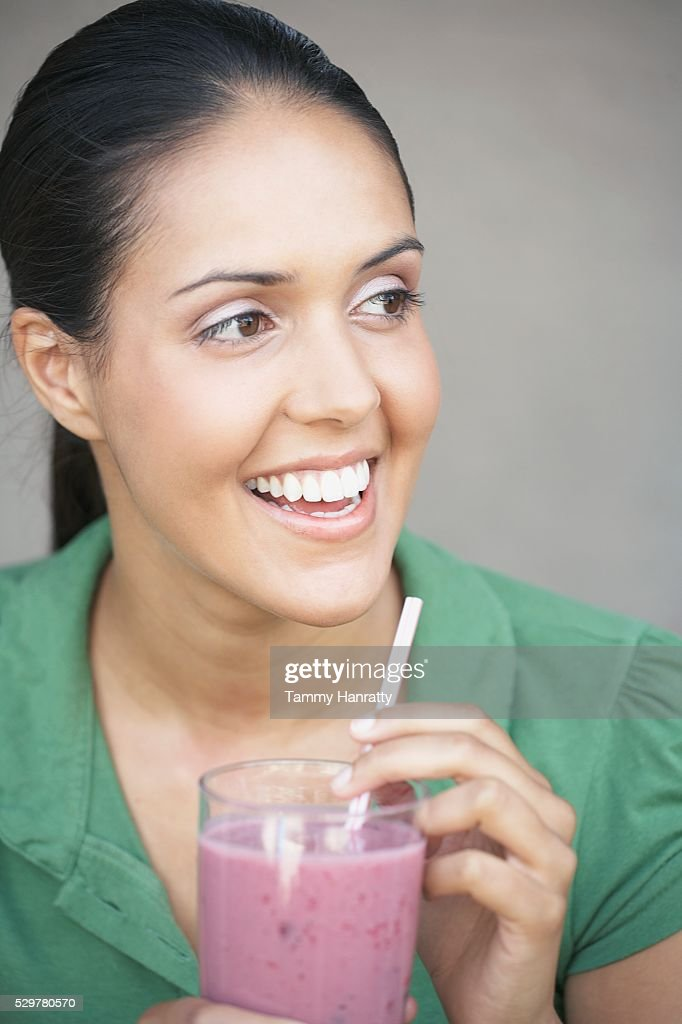 Woman drinking fruit smoothie : Stock Photo
