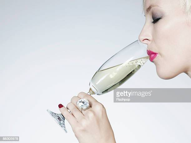 Woman drinking glass of champagne