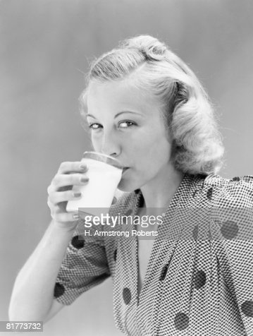 Woman drinking glass of milk.