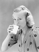 Woman drinking glass of milk.