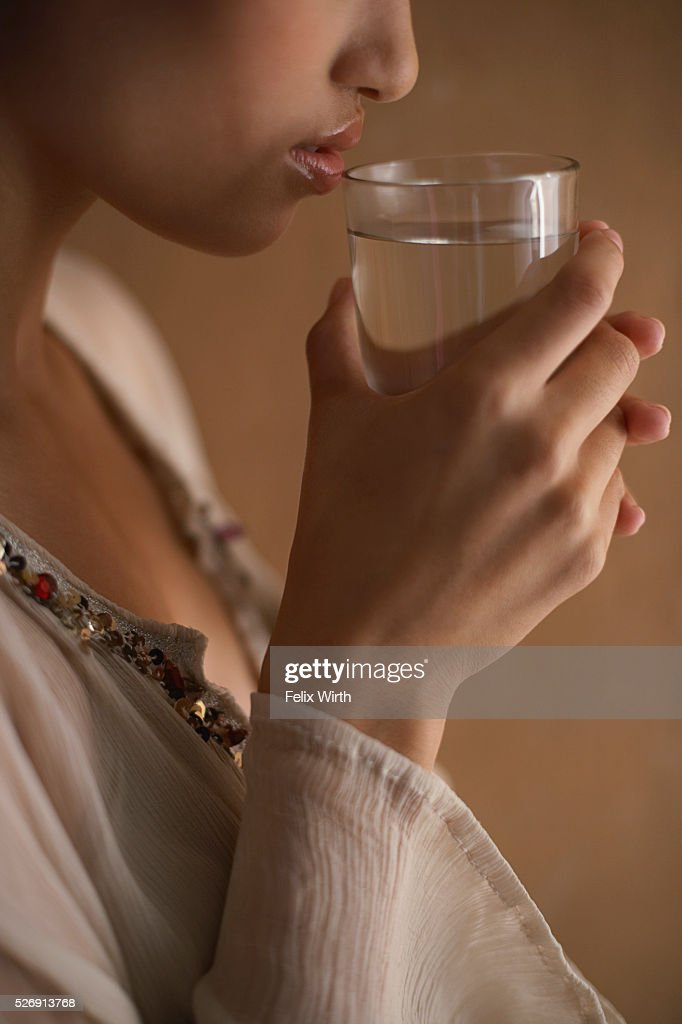 Woman drinking glass of water : Stock-Foto