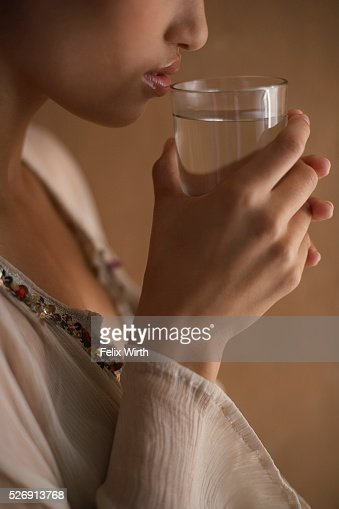 Woman drinking glass of water : Stock Photo