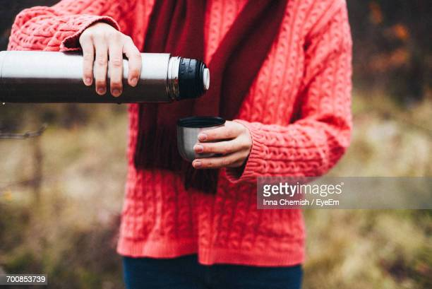 Woman Drinking Hot Beverage Outdoors