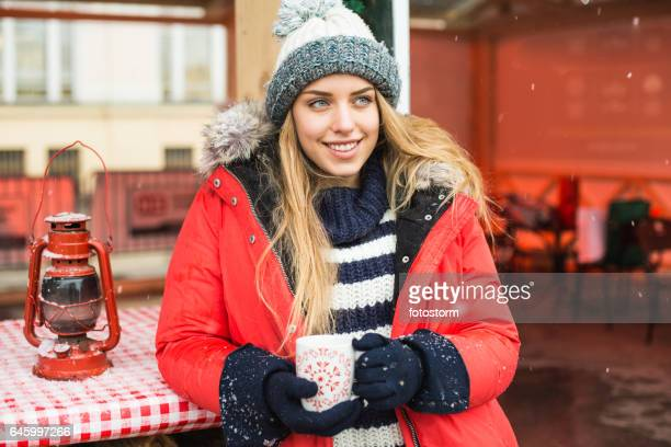 Woman drinking hot wine at the Christmas market