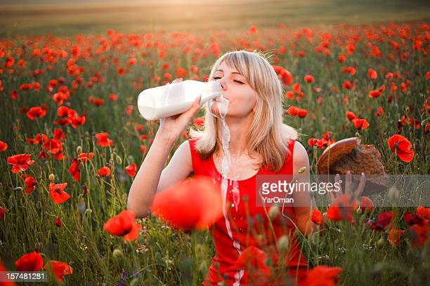 woman drinking milk from a bottle