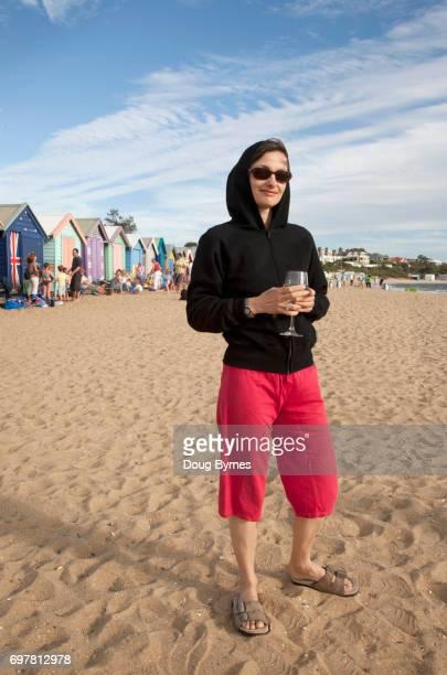 Woman drinking on beach