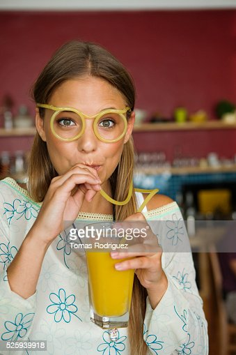 Woman drinking orange juice : Stock Photo