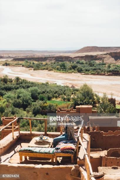 Woman drinking tea in Ait Ben Haddou Casbah