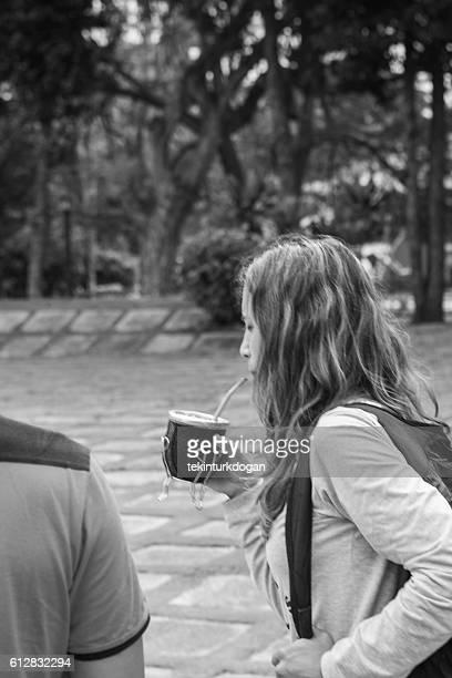 woman drinking traditional mate at santa clara cuba