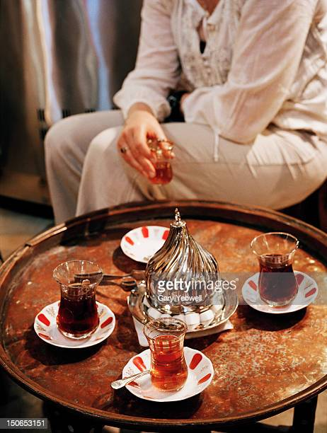 Woman drinking Turkish tea in The Grand Bazaar