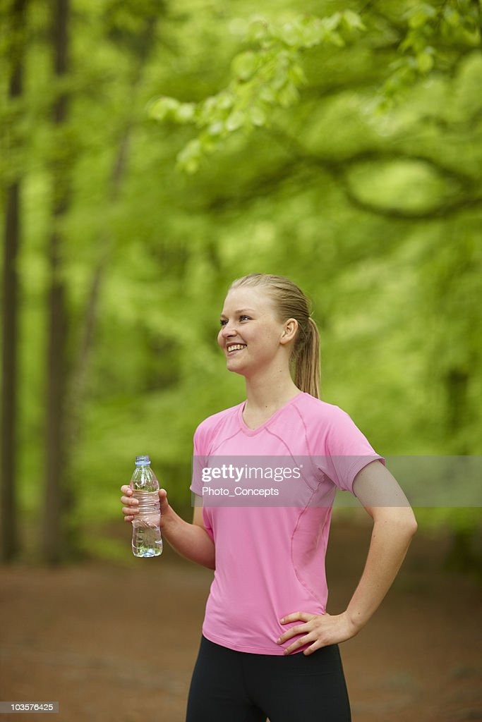 Woman drinking water after run : Stock Photo