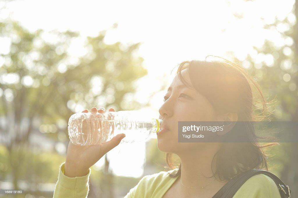 Woman drinking water : Stock Photo