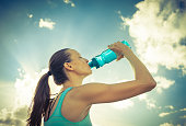 Woman drinking water after workout.