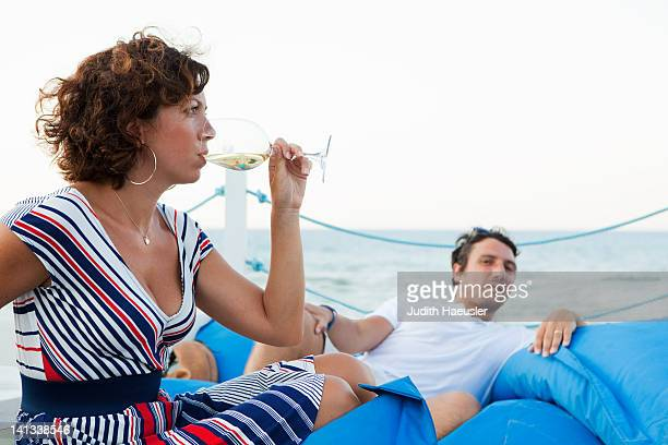Woman drinking wine outdoors