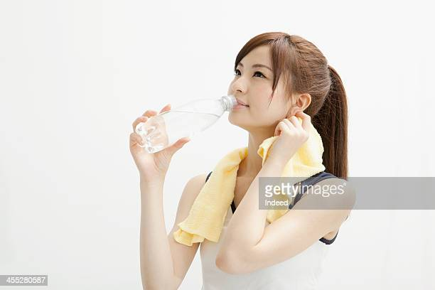 Woman drinks a drink in the sportswear