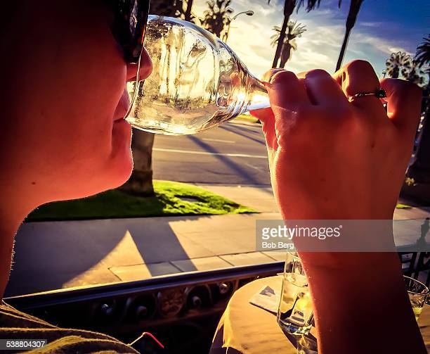 Santa Monica Ca February 11 2015 A woman drinks a glass of Napa valley Luna Punot Grigio