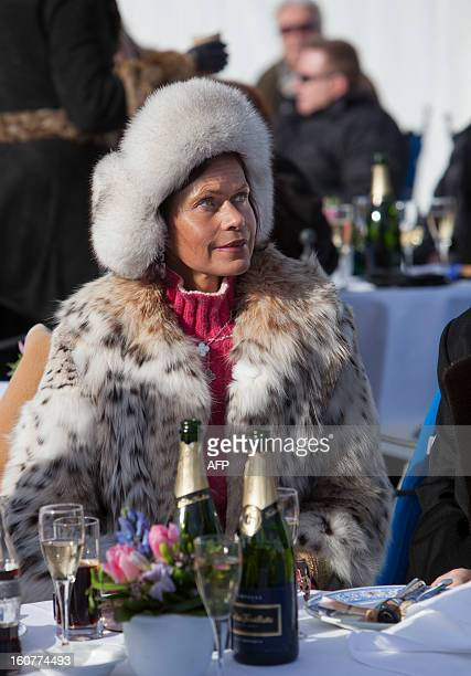 PEDREROA woman drinks champagne at the White Turf horse racing event in St Moritz on February 3 2013 The races are held on the frozen lake of the...