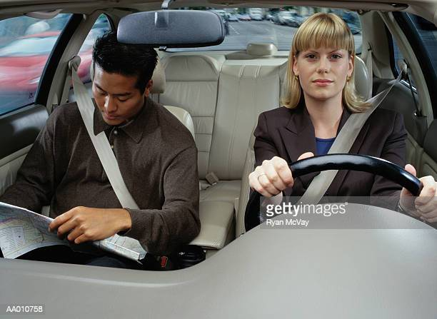 Woman Drives While a Man Reads a Map