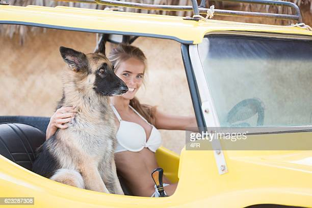Woman driving a Beach Buggy with her Dog