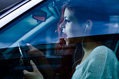 Screaming Woman with Earbuds Driving a Car
