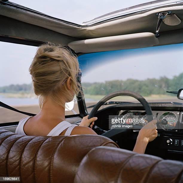 A woman driving a car, Sweden.