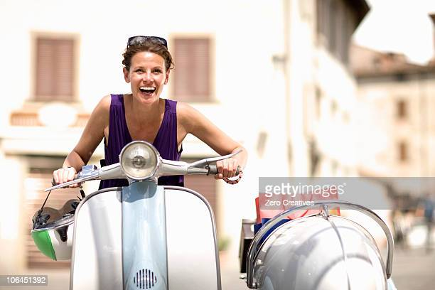 Woman driving a vespa