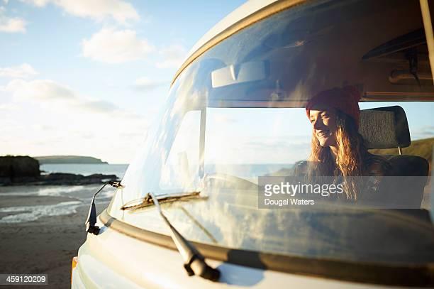 Woman driving camper van.