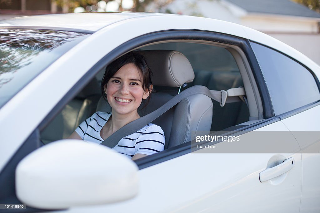 Woman driving car : Stock Photo