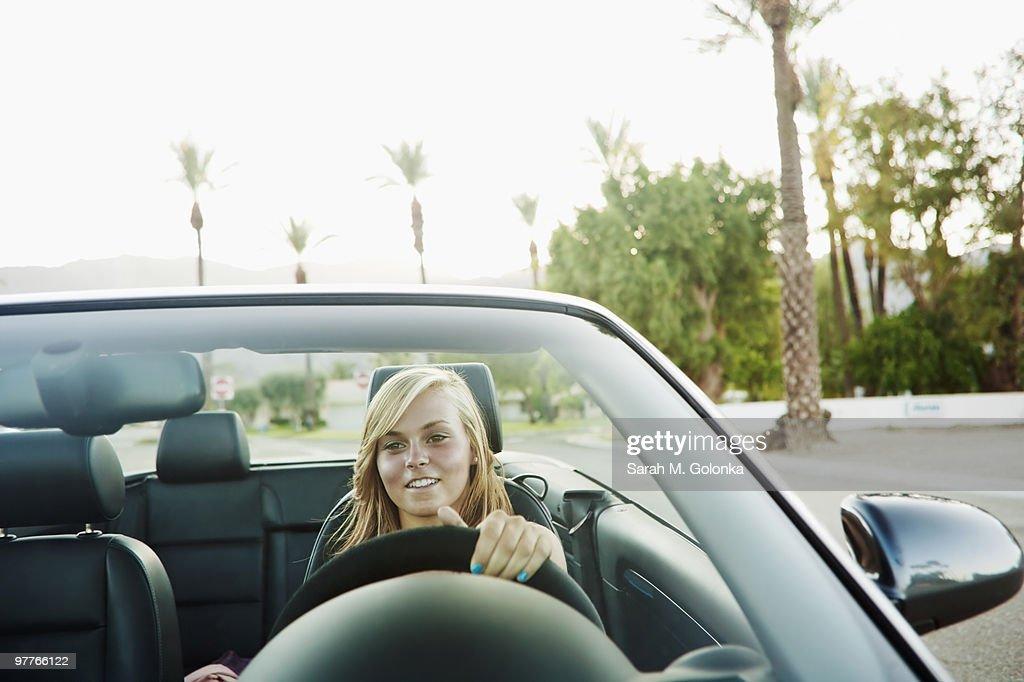 Woman driving convertible