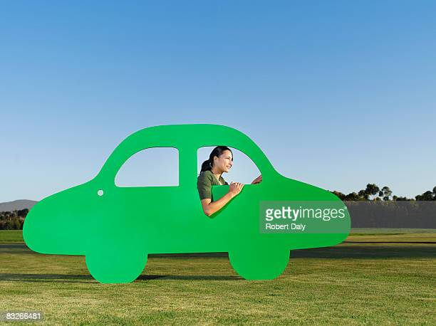 Woman driving cutout car