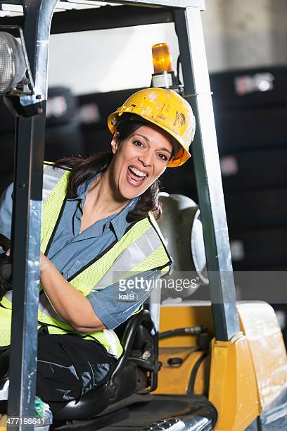 Woman driving forklift