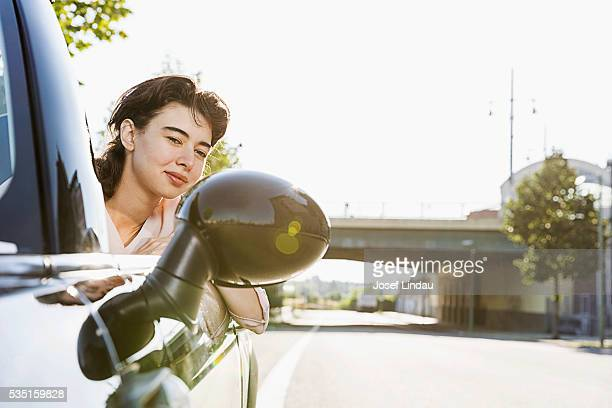 Woman driving open-top car