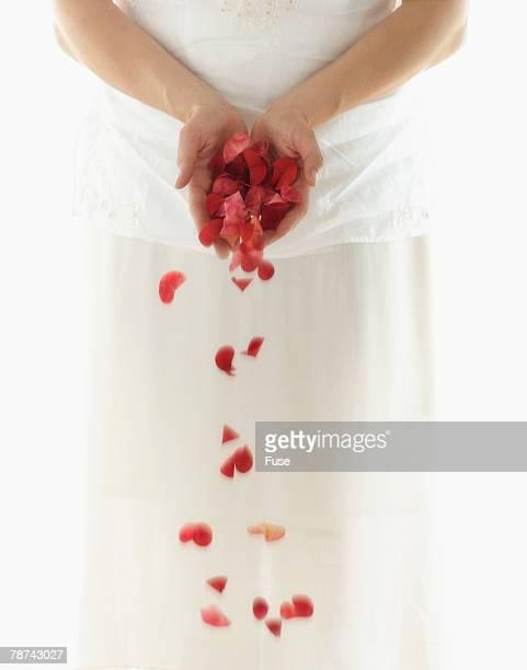 Woman Dropping Rose Petals