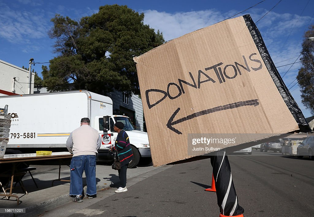 A woman drops off a donation at the Bay Area Rescue Mission on November 19, 2012 in Richmond, California. Days ahead of Thanksgiving, the Bay Area Rescue Mission received a donation of 320 turkeys and 60 hams from local business Bay Alarm that will be used to feed a holiday meal to needy and underpriviledged people.